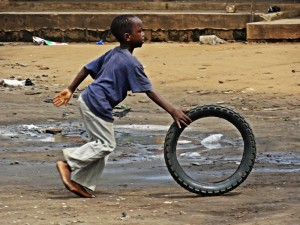 Copyright-N.Ojewska-child-playing-on-the-street-in-Ada